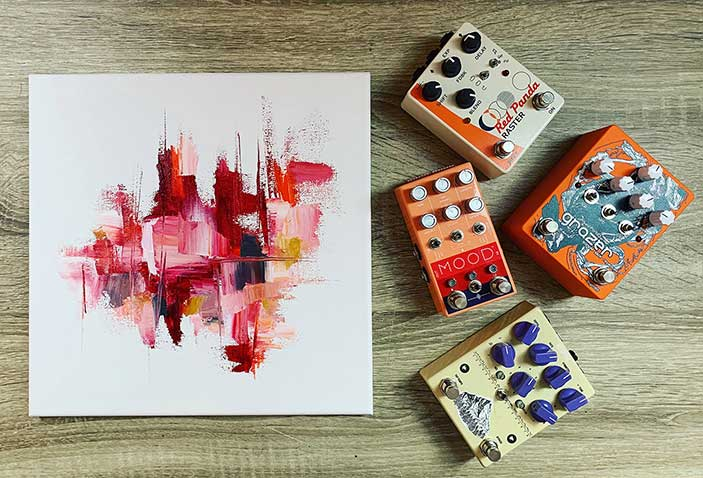guitar pedals and a painting